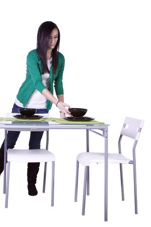 table: Beautiful Teenager Preparing the Dinner Table - Isolated Stock Photo
