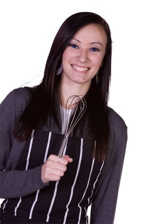 Beautiful Girl Having Fun in the Kitchen Pretending to use Whip as Microphone photo