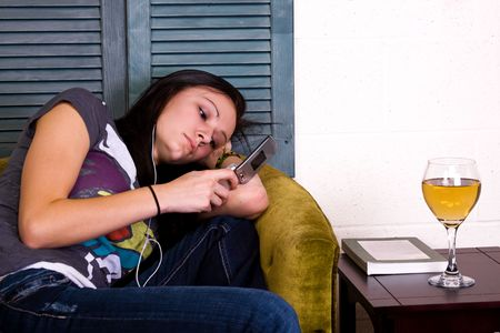 Girl at Home texting sitting on the couch