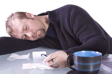 Young Casual Professional at Work Sleeping on his Desk - Isolated Background photo