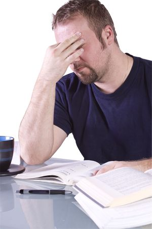 finals: Stressed College Student Studying for his Finals - Isolated Background