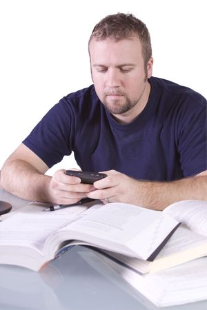 finals: College Student  Studying for his Finals and Talking on his Cell Phone- Isolated Background