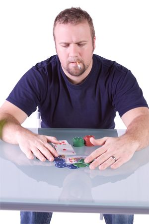 Man with a Royal Flush reaching to get the pot in Texas Holdem Table photo