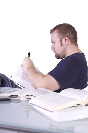 finals: College Student  Studying for his Finals - Isolated Background Stock Photo