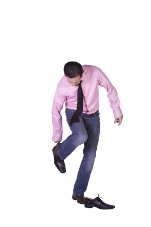 putting up: Casual Man Changing His Shoes Getting Ready - Isolated Background Stock Photo