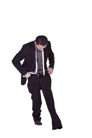 準備 - 孤立した背景に彼のズボンを置くビジネスマン