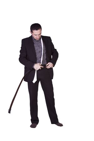 Businessman Putting His Belt On Getting Ready - Isolated Background photo