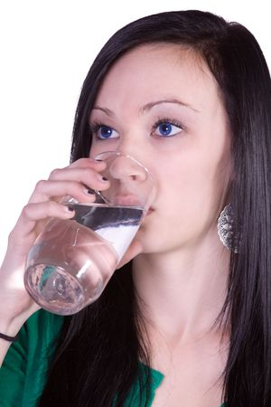Beautiful Teenager Girl Drinking Water on an Isolated Background photo