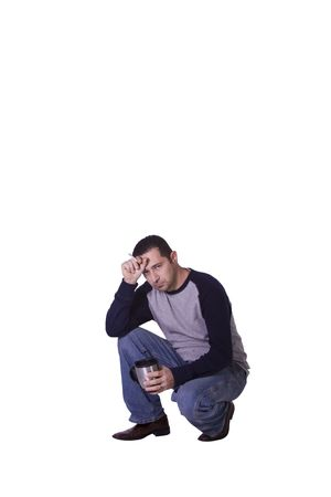 crouched: Crouched Casual Stressed Man Smoking and Drinking Coffee - Isolated Background