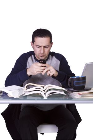 finals: College Student  Studying for his Finals and Texting on his Cell Phone- Isolated Background