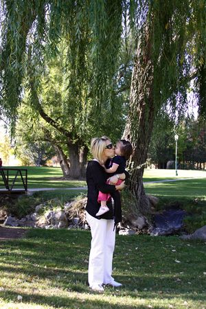 Mother Holding Her Daugther in the Park