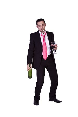 tired businessman: Drunken Businessman Holding a Wine Bottle Trying to Keep his Balance - Isolated Background Stock Photo