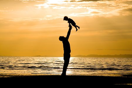 father and son: Father andSson on the Beach - Silhouette Shot Stock Photo