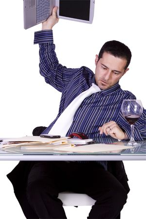 Frustrated Businessman Throwing His Laptop to the Table - Isolated Background photo