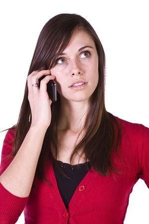 celulas humanas: Close up Shot de un Beautiful Girl Talking sobre los tel�fonos m�viles - aislada  Foto de archivo