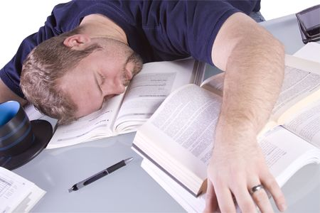 College Student Falling Asleep while Studying for his Finals - Isolated Background photo