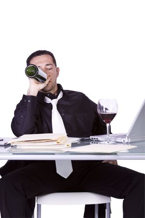 Isolated Drunk Businessman At His Desk Working And Drinking Wine - White Background photo