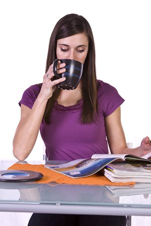 Beautiful Woman Relaxing by Reading a Magazine and Drinking Coffee Stock Photo - 6603362