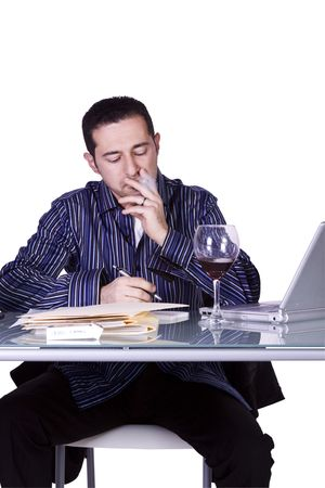 Isolated Businessman At His Desk Working and Drinking Wine- White Background photo