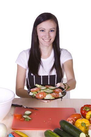 Cute Teenager in the Kitchen Handing a Plate of Salad Stock Photo