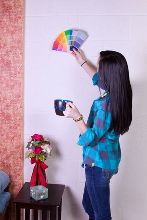 Beautiful Girl Choosing a Color to Paint the Wall photo