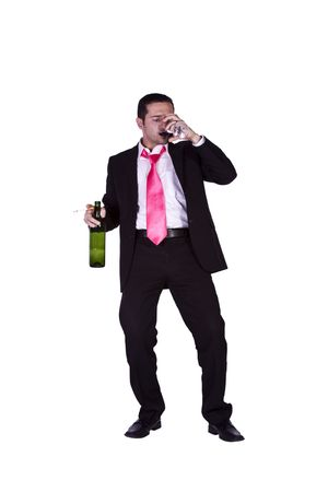 Drunken Businessman Holding a Wine Bottle Trying to Keep his Balance - Isolated Background photo