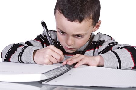 Little Kid Practices Writing on a Notebook Stock fotó