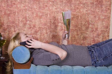 Teenager Talking on the Cell Phone on a Green Couch photo