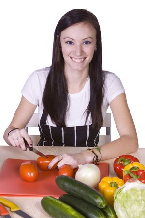 Cute Teenager in the Kitchen Preparing Food photo
