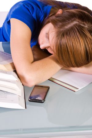 College Student Falling Asleep while Studying for her Finals - Isolated Background photo