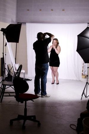 Photographer Taking Pictures of a Model in the Studio photo