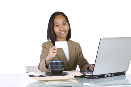 Isolated Businesswoman At Her Desk Holding a Blank Business Card photo