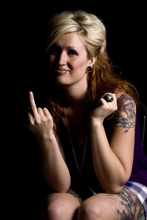 Close up on a Woman Giving a Middle Finger - Black Background
