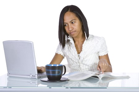Isolated Businesswoman At Her Desk Working - White Background photo