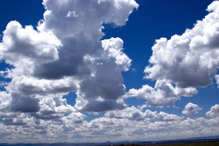 reflect: Clouds with Blue Skies in the background Stock Photo