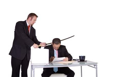One Businessman Forcing Another to Sign A Contract - Isolated Background photo