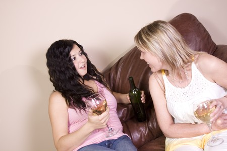 Friends Socializing at Home and Drinking Wine photo