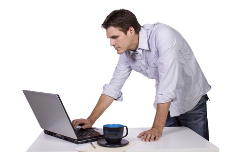 Isoalted Businessman browsing internet on laptop at work Stock Photo - 7998145