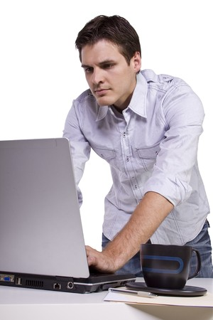 Isoalted Businessman browsing internet on laptop at work Stock Photo - 7998230