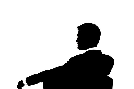 shadow: Silhouette of a businessman isolated on white background