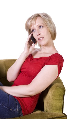 Woman talking on her cell phone at home- Isolated Background Stock Photo - 7998255
