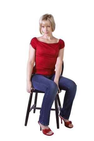 Stylish Blonde fashion model hair sitting on chair - Isolated  Stock Photo - 7998139