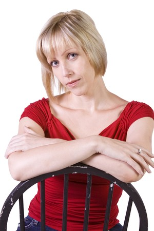 Stylish Blonde fashion model hair sitting on chair - Isolated