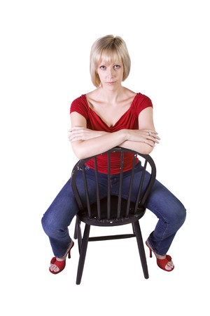 Stylish Blonde fashion model hair sitting on chair - Isolated  photo
