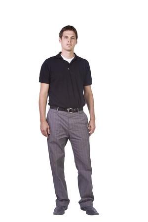 Geïsoleerde Shot van een goed kijken jonge man standing up Stockfoto