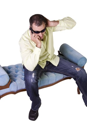 Isolated Man in trendy outfit with sunglasses talking on cell phone photo