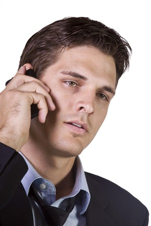 Isolated Young businessman conversing on cell phone photo