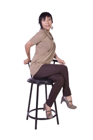 comfortable chair: Beautiful Woman Posing on a Chair - Isolated White Background