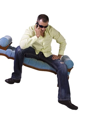Isolated Man in trendy outfit with sunglasses talking on cell phone Banco de Imagens