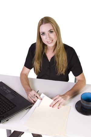 Isolated Businesswoman working on laptop with cup of coffee on her desk photo